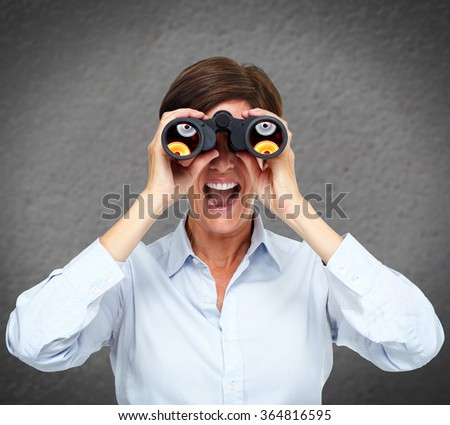 Business woman with binoculars. - stock photo