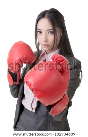 Business woman with boxing gloves, closeup portrait.