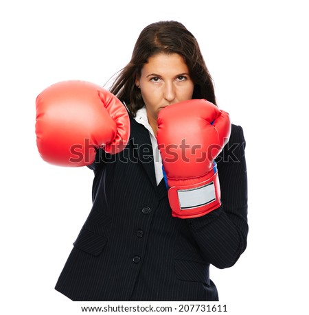 Business woman with boxing gloves punching straight into camera   Isolated on a white background. - stock photo