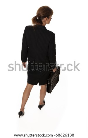 Business woman with briefcase walking away - stock photo