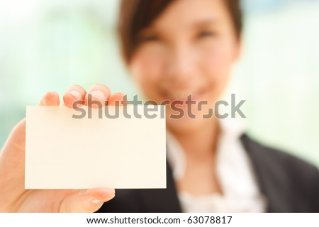 Business woman with business card - stock photo