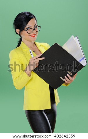 Business woman with clipboard on chroma green background  - stock photo