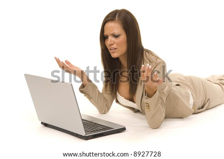 Business woman with computer, expressing despair