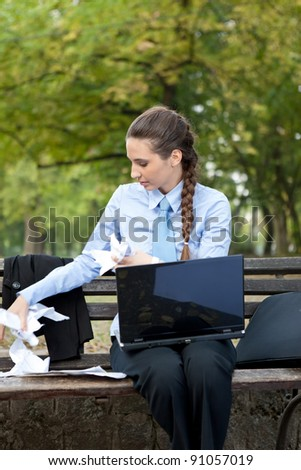 business woman with crumpled paper in his hands,  outdoor - stock photo