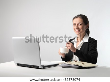 business woman with cup of coffee and laptop