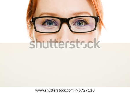 business woman with glasses hidden behind a white sheet of paper