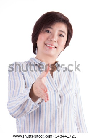 Business woman with hand extended to handshake - isolated over white - stock photo