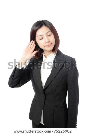 Business woman with hand to ear listening isolated on white background, model is a asian beauty - stock photo