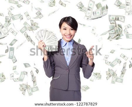 business woman with handful of money giving thumbs up with money rain, asian beauty model - stock photo