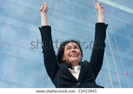 Business woman with hands up - stock photo