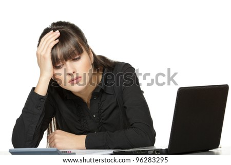 Business woman with head in hands, looking at calculator exhausted, over white background