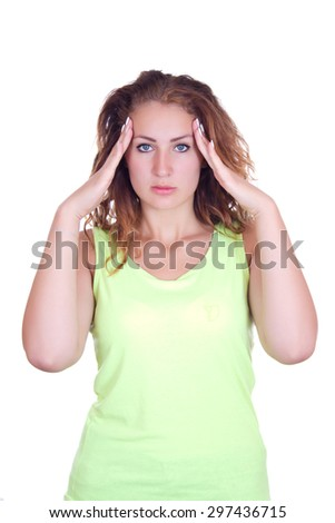Business woman with headache holding hands to her aching temples. - stock photo