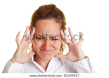 Business woman with headache holding hands to her aching temples - stock photo