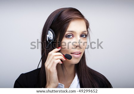 Business woman with headset. Isolated over white background - stock photo