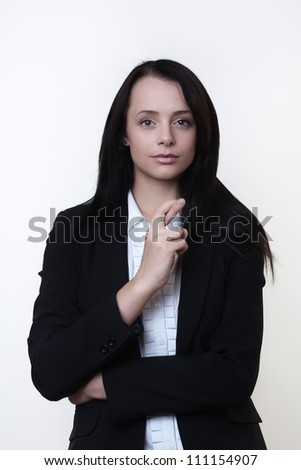 business woman with her finger crossed hoping the big deal she put together come off