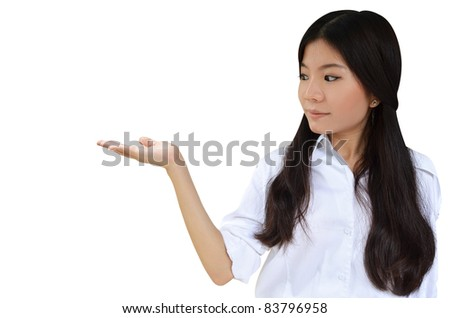 Business woman with her hand open to show a product isolated on white background - stock photo