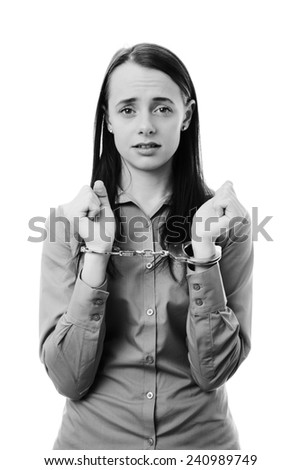 business woman with her hands chained up in police handcuff - stock photo