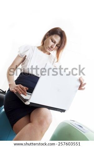 business woman with her suitcases ready to go - stock photo