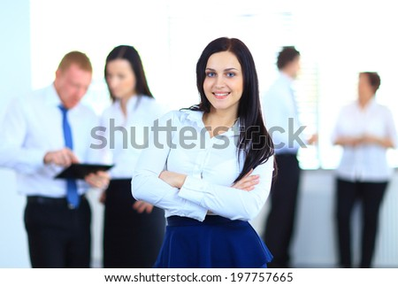 Business woman with her team at the office - stock photo