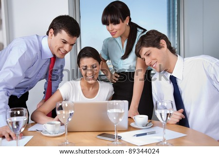 Business woman with her team working on laptop - stock photo