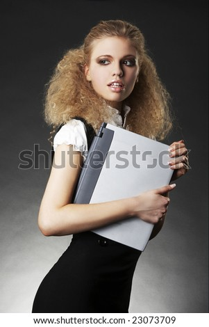 business woman with laptop on gradient background - stock photo