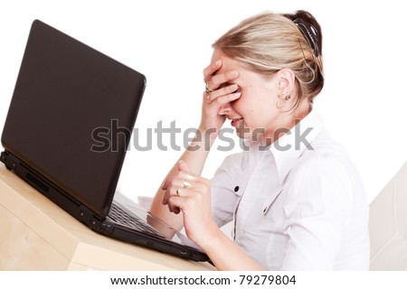 Business woman with laptop worrying