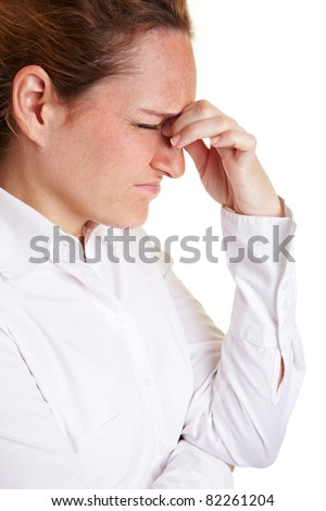 Business woman with migraine massaging bridge of nose - stock photo