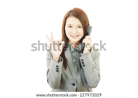 Business woman with ok hand sign - stock photo