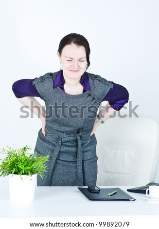 Business woman with pain in her back - stock photo