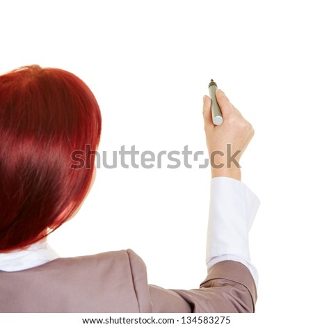 Business woman with pen writing into the air - stock photo