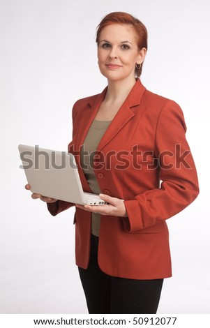 business woman with red sack coat and laptop - stock photo