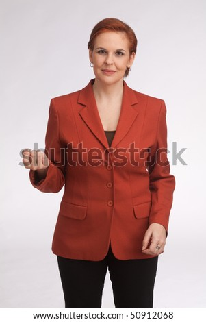 business woman with red sack coat and red hair - stock photo