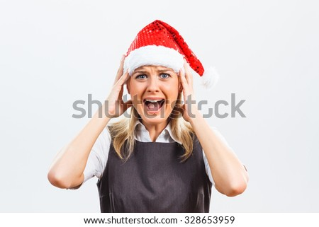 Business woman with Santa Hat is in panic because of something.Business woman with Santa Hat in panic