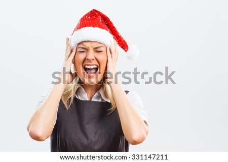 Business woman with Santa Hat is very frustrated because of something.Frustrated business woman with Santa Hat