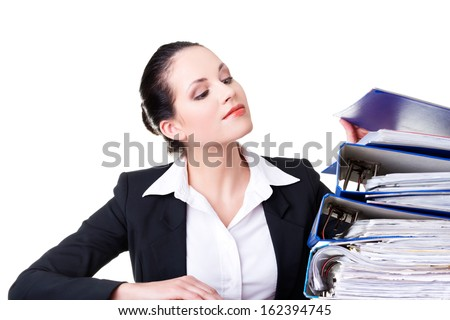 Business woman with stack of binders. Isolated on white.  - stock photo