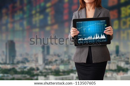 Business woman with stock graph report - stock photo