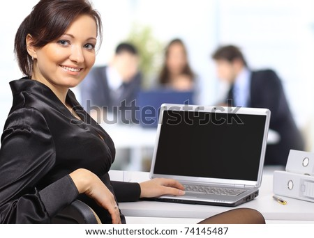 business woman with team working on laptop - stock photo