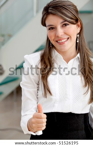 Business woman with thumbs up and smiling