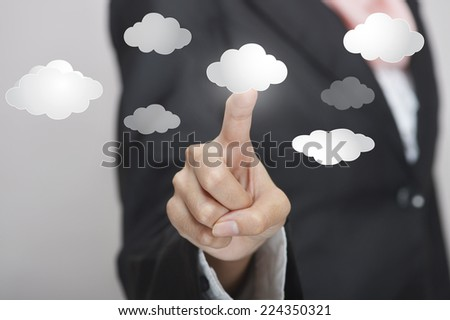 Business woman with virtual cloud interface - stock photo