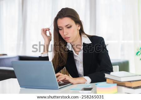 business woman working at a computer in the office - stock photo