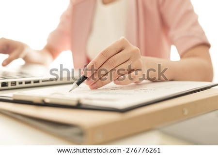 business woman working at office - stock photo