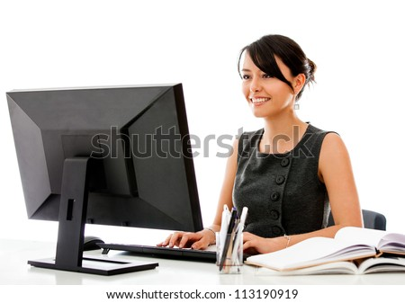 Business woman working at the office with a desktop computer - stock photo