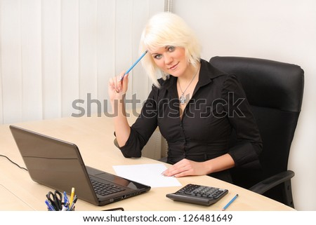 Business woman working in office - stock photo