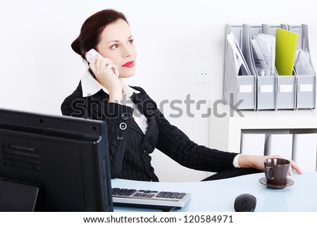 Business woman working in office. Talking by phone.