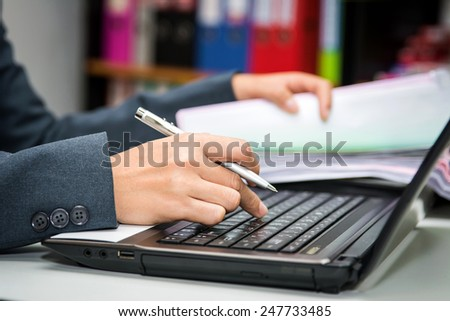 Business woman working in office with laptop