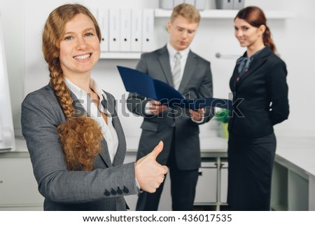 business woman working in office with two person at background