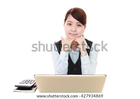 Business woman working on a laptop - stock photo