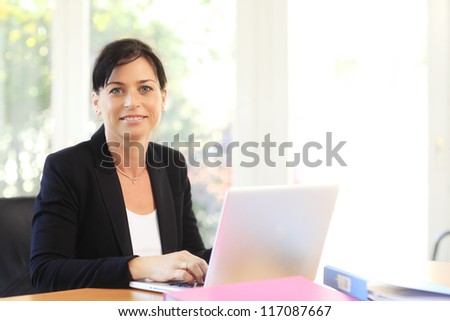 Business woman working on a laptop at office