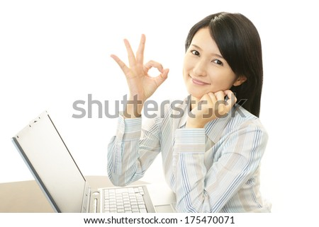 Business woman working on laptop  - stock photo