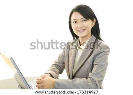 Business woman working on laptop